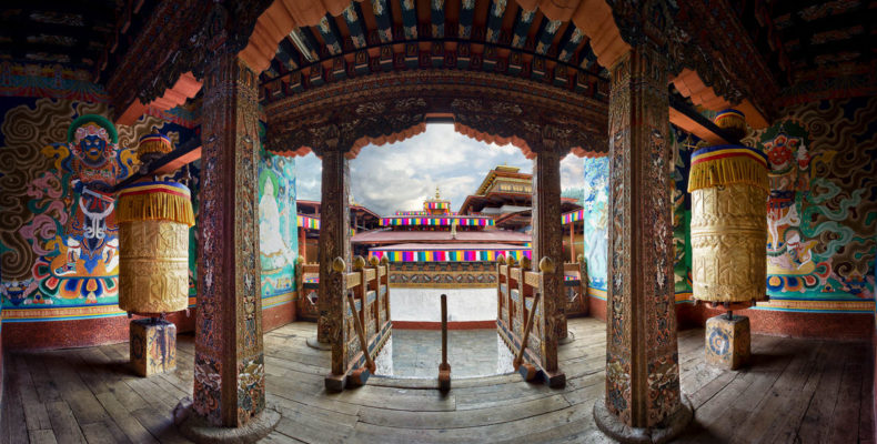 The Punakha Dzong is one of Bhutan's largest and most spectacular dzong's, the center for government administration and religion in each of Bhutan's districts.  Inside the Dzong, near the main temple, is the beautiful landing pictured here, flanked by huge golden prayer wheels and intricate colorful religion murals.  This panorama was taken just days before the Royal Wedding took place at the Dzong, which had been cleaned and decorated for the occasion.  HDR Efex Pro and Photoshop were used to craft this image.